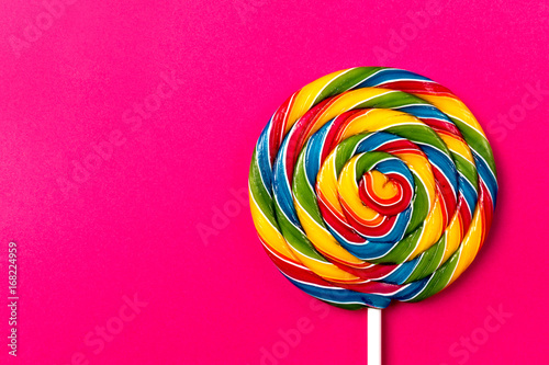 Photo  Tasty appetizing Party Accessory Sweet Swirl Candy Lollypop on Pink Background T