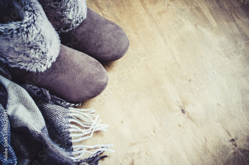 Fotografie, Obraz  Warm home clothes. Woolen plaid and home slippers.