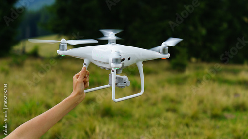 White professional camera quadcopter drone takes pictures