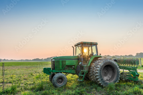 Tractor in a field on a Maryland Farm near sunset Canvas Print