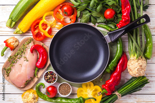 Fototapeta  Raw chicken breast fillets with vegetables ingredients in pan