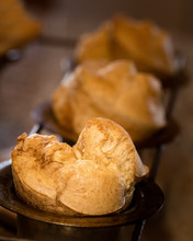 Golden Brown Popovers In Pan With Shallow Focus