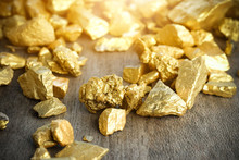 Close Up Lump Of Gold Mine On Wooden Table