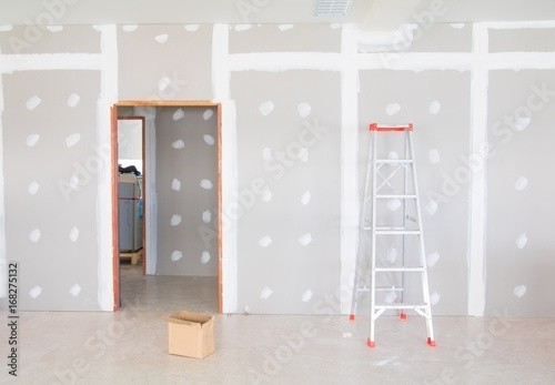 Fotografie, Obraz  stair and gypsum board wall interior decoration of home at construction site wit