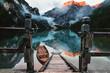 Leinwandbild Motiv Sonnenaufgang am Bootshaus am Lago di Braies/Pragser Wildsee