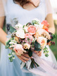 canvas print picture - bouquet of flowers in brides hands