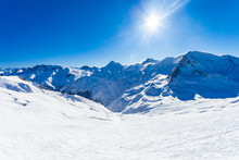 Panoramic View Over Empty Slope And Valley In The Background, Snow And Sun, Winter Picture Of Samnaun, Swiss Alps, Switzerland, Europe.