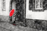 A girl in the rain with a red umbrella and red labuten in the city. Photo processed in retro styles