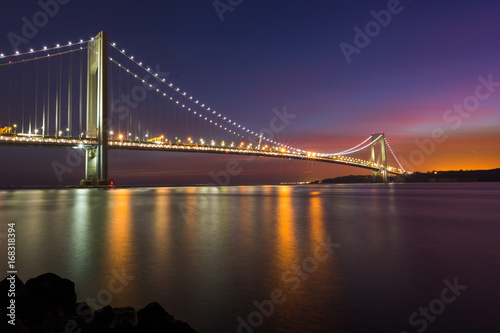 Colorful sunset sky at the Verrazano Narrow Bridge, New York.