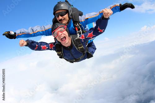 Photo  Skydiving. Tandem jump. Happy Passenger.