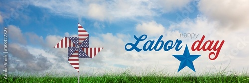 Happy labor day text and USA wind catcher in front of grass and