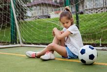 Small Child Wearing Sport Clot...