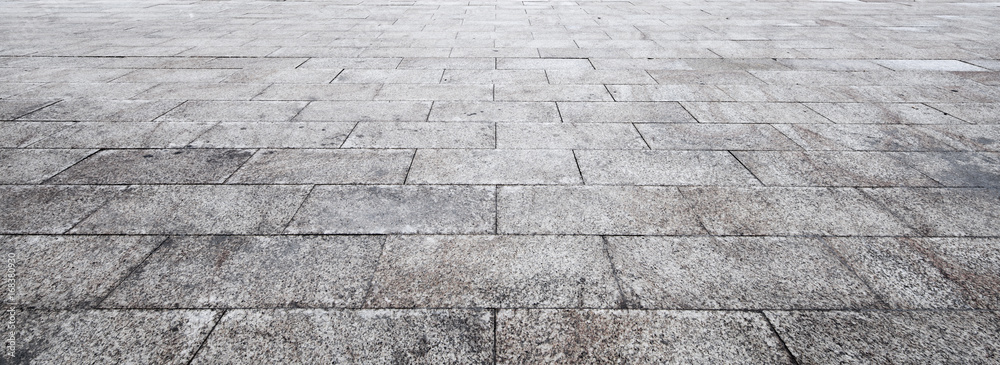 Fototapeta Perspective View of Monotone Gray Brick Stone on The Ground for Street Road. Sidewalk, Driveway, Pavers, Pavement in Vintage Design Flooring Square Pattern Texture Background