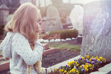 Sad Girl In Front Of Grave