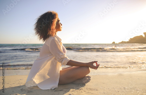 Canvas Prints Relaxation Girl doing yoga at the beach, at sunset time