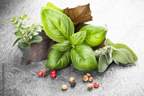 Obraz Herbs and spices over black stone background. Top view. - fototapety do salonu