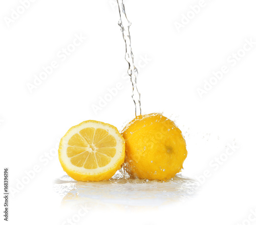 Poster Eclaboussures d eau Fresh lemons with jet of water on white background