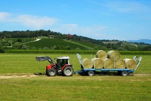 A Tractor With Its Trailer Loa...