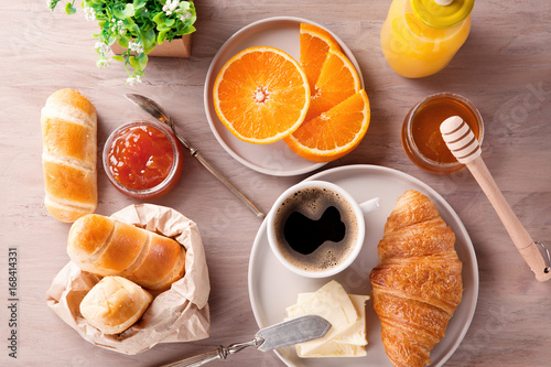 Breakfast with coffee, orange juice and croissant. Top view © netrun78