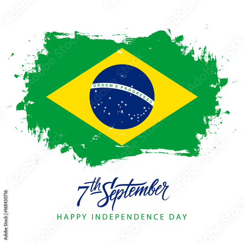 Foto  Brazil Independence Day, 7 september greeting card with hand lettering and brazilian national flag brush stroke background