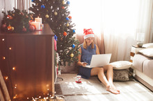 Cute Young Woman Shopping Online - Holding Credit Card And Feeling Happy In Awaiting Christmas Holiday
