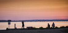 People Watch A Sunset Over West Wittering Beach, Chichester Harbour, Sussex