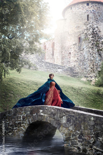 Fototapeta  Beautiful Isabella of France, queen of England on Middle Ages period in red gown