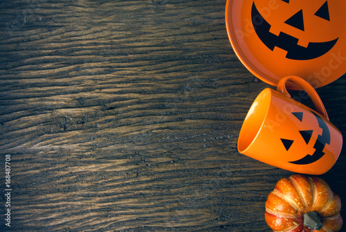 Fényképezés  halloween and pumpkin dish and coffee mug cup on wood table