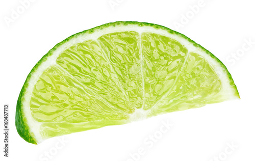 Ripe slice of green lime citrus fruit lying isolated on white background with clipping path
