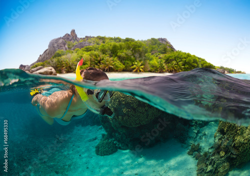 Snorkeling woman exploring beautiful ocean sealife