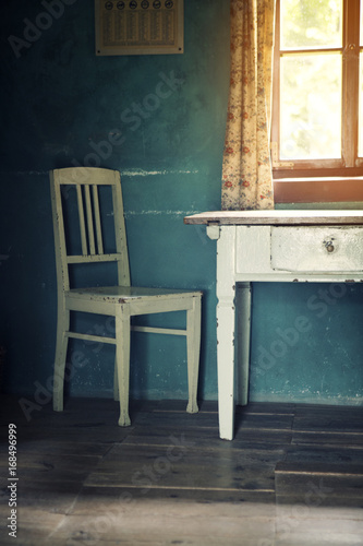 room with old vintage chair and table