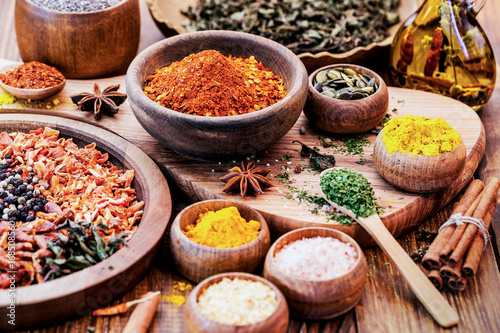 Fotografering Spices and Herbs on Wooden Background