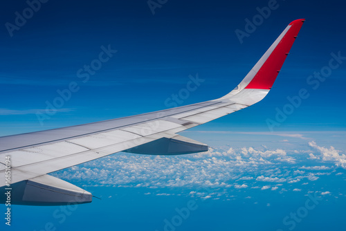 An aircraft wing and cloud formation view from aircraft window Canvas Print