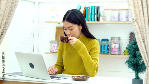 Lovely girl bring hot coffee to her friend in the living room Wallpaper Mural