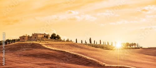 Fototapeta Beautiful typical panorama landscape of Tuscany at sunset, Italy