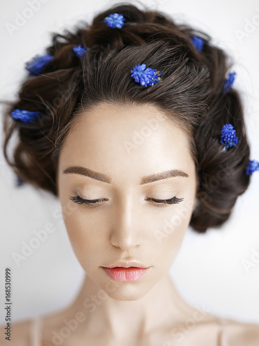 Fototapeta  Beautiful young woman with blue muscari in her hair