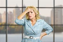 Worried Woman On Office Backgr...