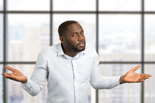Photo  Black man with hands in different sides