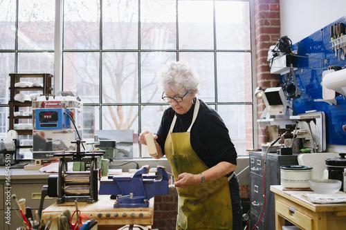Art Jeweler Working in Studio