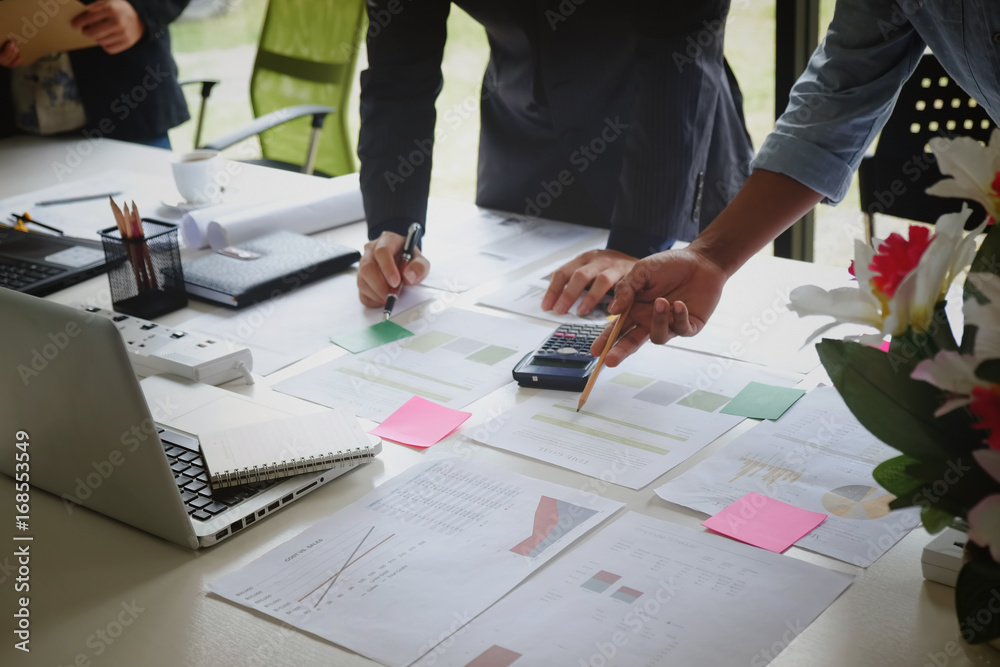 Fototapeta Business adviser analyzing financial figures denoting the progress in the work of the company