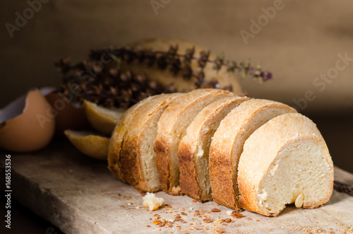 Poster Brood Sliced bread on rustic wooden,Homemade bakery cooking at home,Healthy food