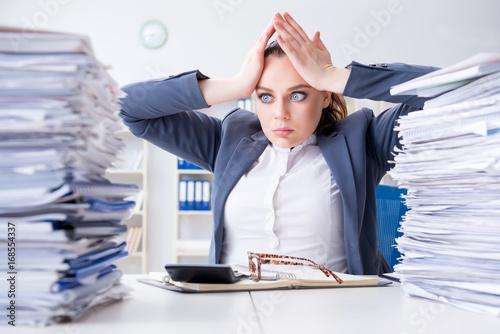 Fotografía Tired businesswoman with paperwork workload