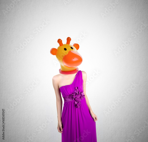 Photo Woman or Giraffe headed woman with concept on a background.