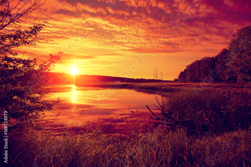 Deurstickers Oranje eclat Early morning, sunrise over the lake. Misty morning, rural landscape, wilderness, mystical feeling