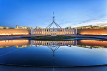 Dramatic Evening Sky Over Parliament House, Illuminated At Twilight. Which Was The World's Most Expensive Building When It Was Completed In 1988 In Canberra, Australia