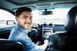 Happy man sitting in car