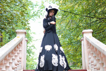 Girl In Old Retro Dress On Sta...