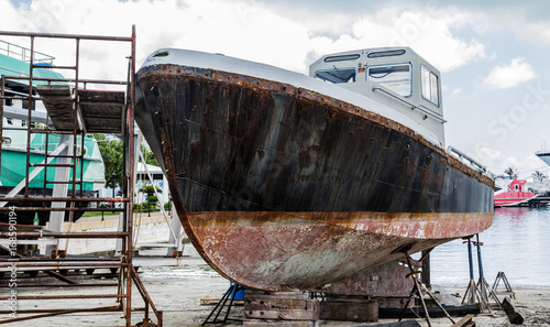 Photo Stands Ship Rusty Hull in Dry Dock