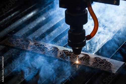 Fotografie, Obraz  Laser makes engraving on leather belt