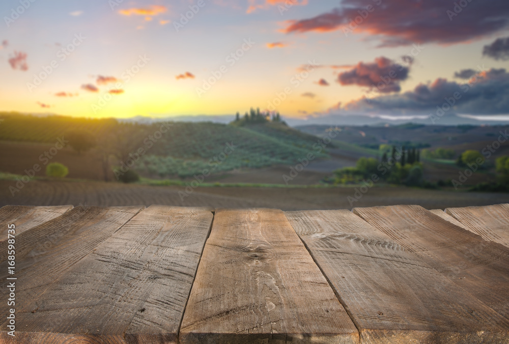 Empty wooden table with Italian landscape on background. Ideal for product placement